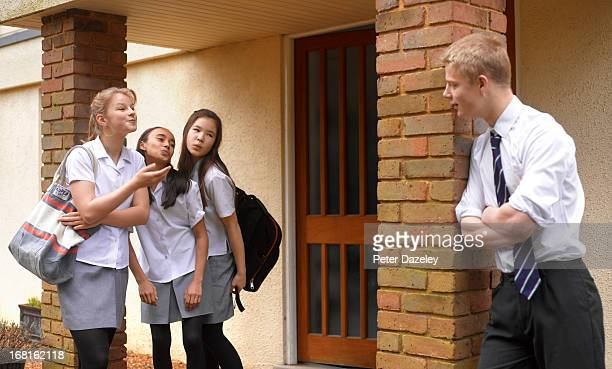 school girls blowing kisses to school boy - indian girl kissing stock photos and pictures