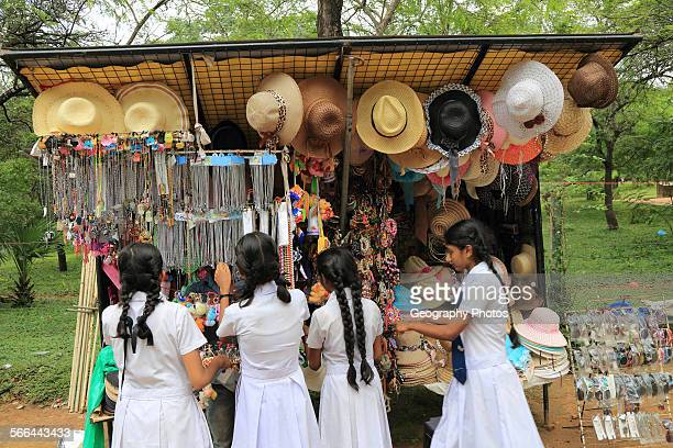 School girls browsing souvenir stall Polonnaruwa North Central Province Sri Lanka Asia