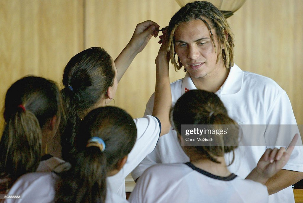 School girls checkout Jade Norths hair during the official welcoming ceremony for the Turkish soccer team held at the Sydney Opera House, May 20, 2004 in Sydney Australia.