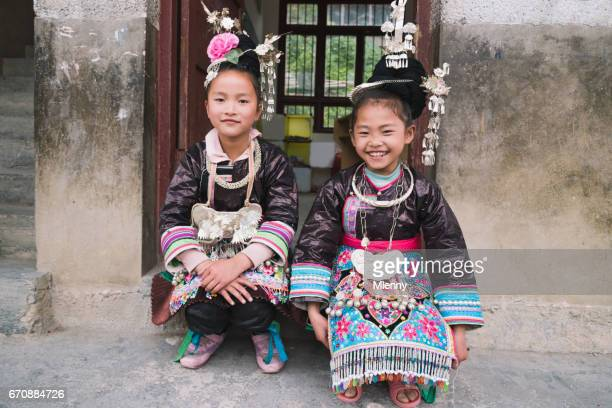 school girls dong people huanggang china - traditional clothing stock pictures, royalty-free photos & images