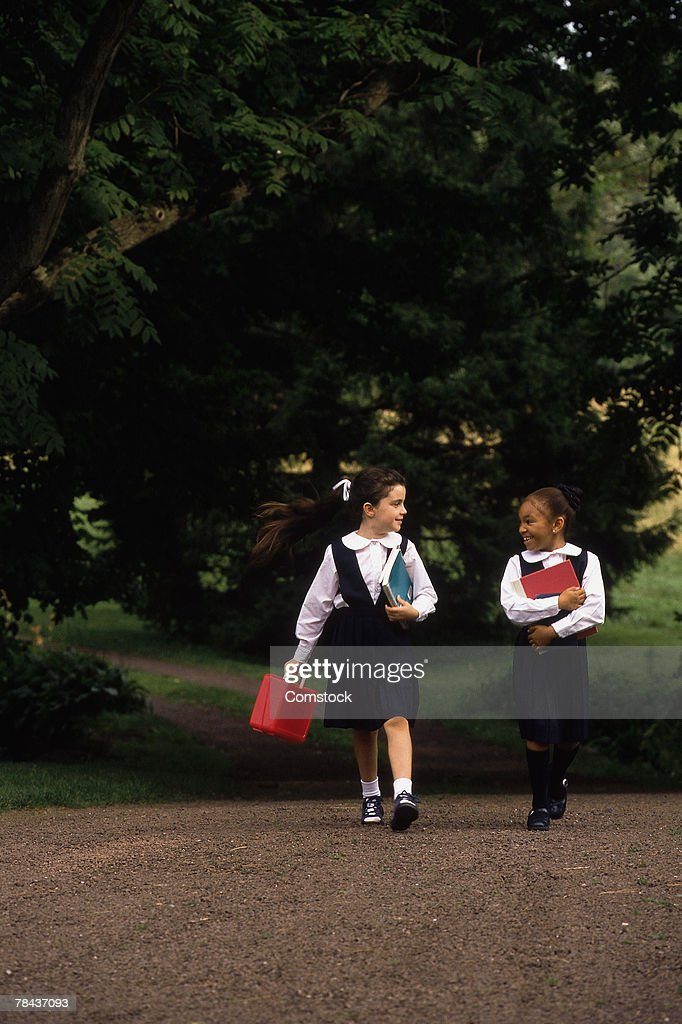 School girls in uniform walking : Stockfoto
