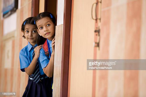 School girls peeping from a classroom