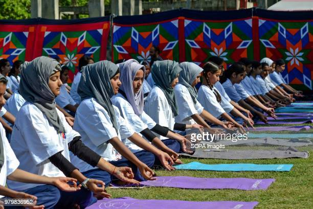 School girls perform yoga at a park to mark International Yoga Day in Srinagar Indian administered Kashmir Hundreds of Yoga Practitioners...