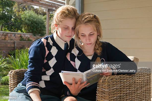 School girl's reading diary together