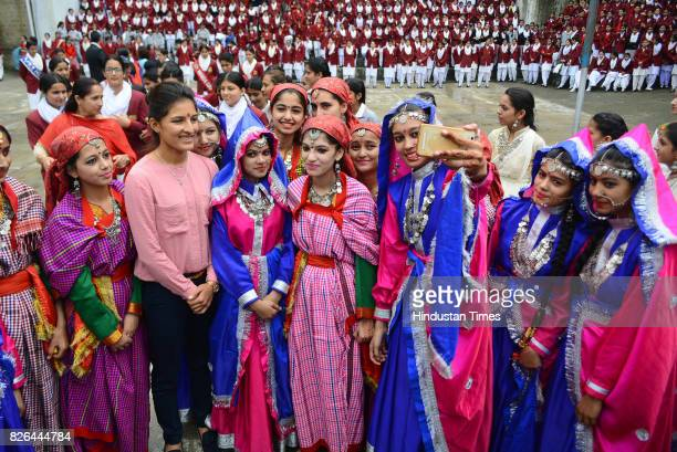 School girls take picture with Indian women cricket team member Sushma Verma during her visit of her old school Government senior secondary school...