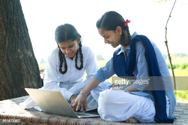 school girls using laptop - girls stock pictures, royalty-free photos & images