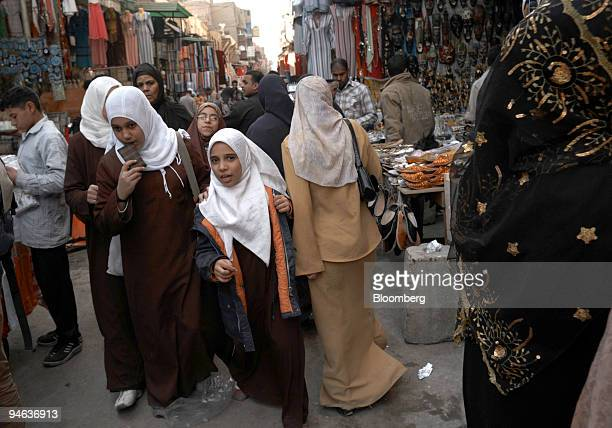School girls walk through the crowded market on Muizz Il Din Allah Street in the historic Fatimid district of Cairo Egypt on Sunday Dec 16 2007 Amid...