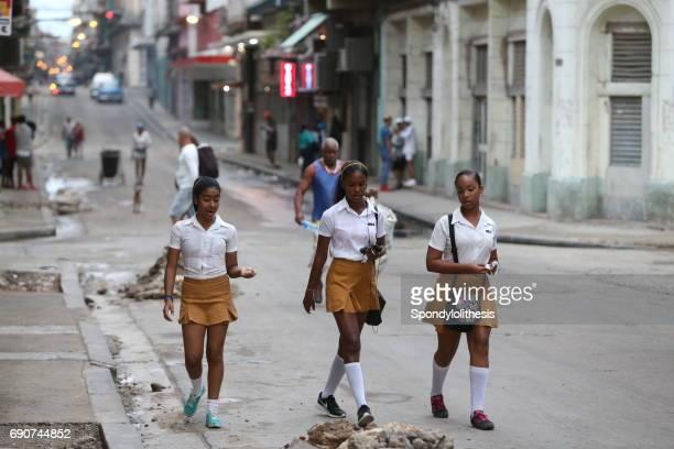 School girls walking on the street, HAVANA, CUBA