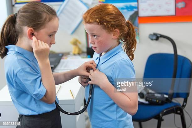 School Girls With Stethoscope
