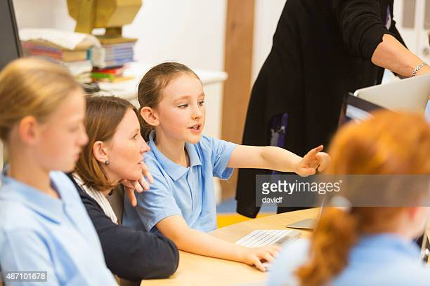School Girls With Teacher and Computer