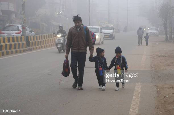 School going children seen in warm clothes on a cold winter morning at sector10 road near Pataudi road police station on December 21 2019 in Gurugram...