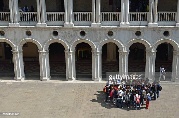 School group at Doge's Palace courtyard, Venice, Italy, Europe