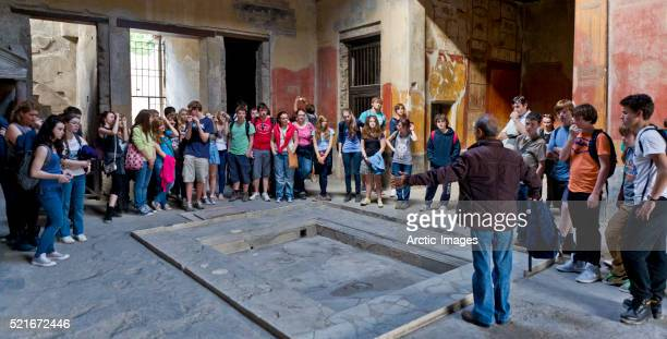 School group by the atrium in The House of Menander, Pompeii, Italy