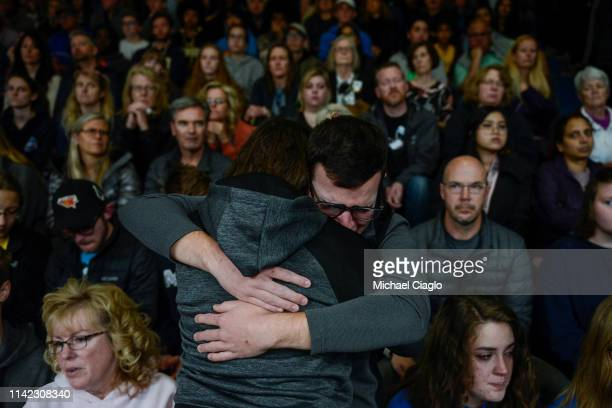 School Highlands Ranch senior Jason Hristopoulos hugs a friend during a candlelight vigil at Highlands Ranch High School on May 8, 2019 in Highlands...