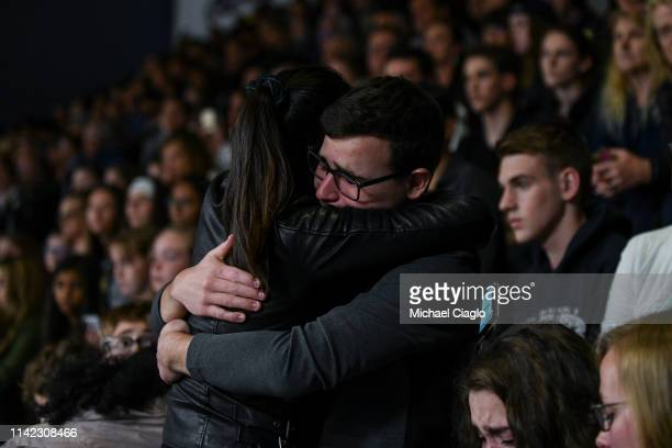 School Highlands Ranch seniors Jason Hristopoulos and Maxine Li embrace during a candlelight vigil at Highlands Ranch High School on May 8 2019 in...
