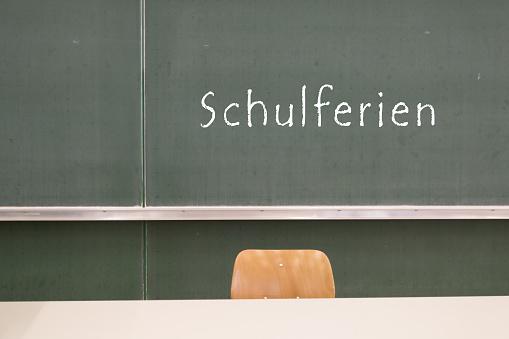 School holidays blackboard 1086610060
