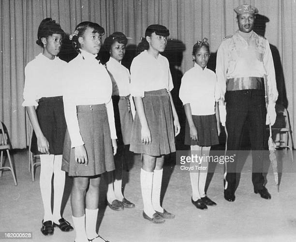 FEB 20 1969 FEB 26 1969 School Honors Drill Team Leader Elmer Jackson 3066 Birch St works with part of the 28 girls in his Columbine Drill Team...