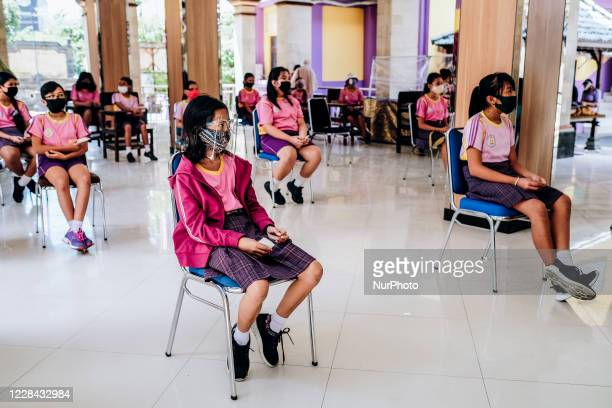 School in Jimbaran, Bali, Indonesia, with the local health centre, facilitates the students with Measles-Rubella and Cervical Cancer immunization, on...
