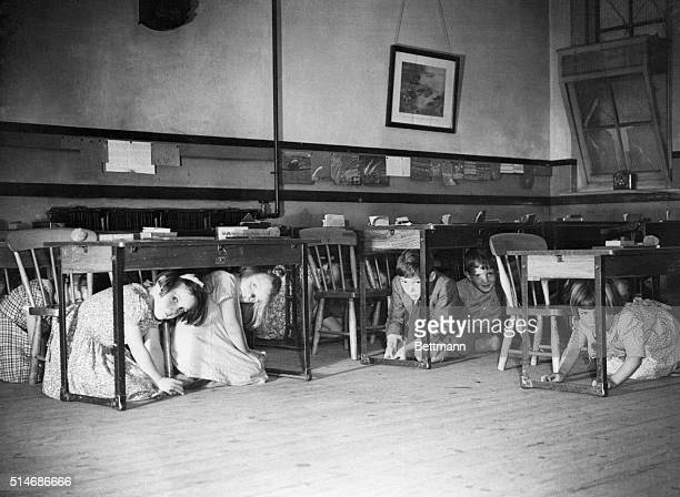A school in southern England performs an air raid drill in response to German bombing raids in the area