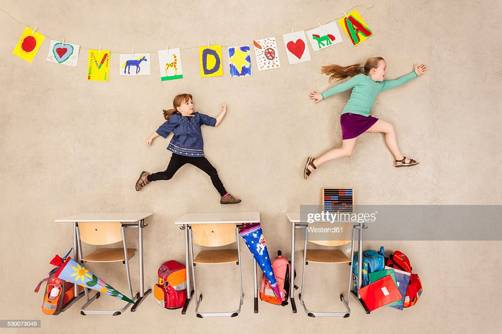 School kids chasing in class room : Stock Photo