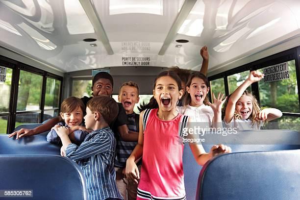 School kids gesturing on school bus