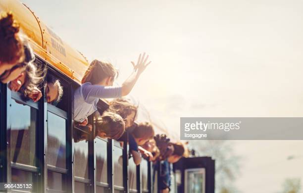 school kids in a bus - free images for educational use stock pictures, royalty-free photos & images