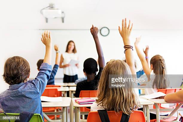 school kids in classroom - classroom stock photos and pictures