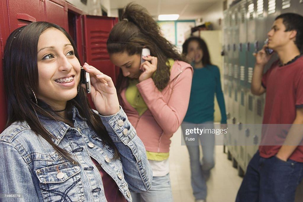 School kids on cell phones between classes : Stock Photo