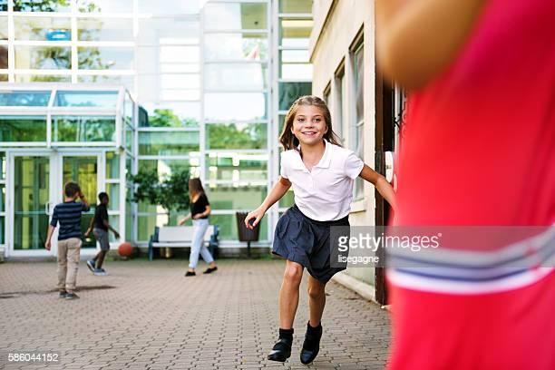 School kids running at school