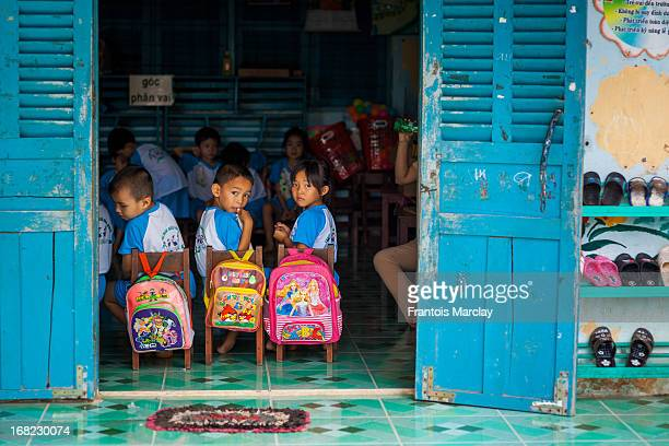 School kids sitting in a colorful kindergarten in Can Tho on an island of the Mekong Delta.