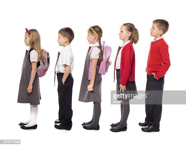 School Kids Standing In Line, Studio Isolated
