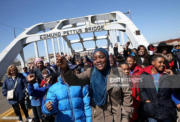 School kids walk across the Edmund Pettus Bridge as they visit historic sites from the Selma to Montgomery civil rights march on March 6, 2015 in...