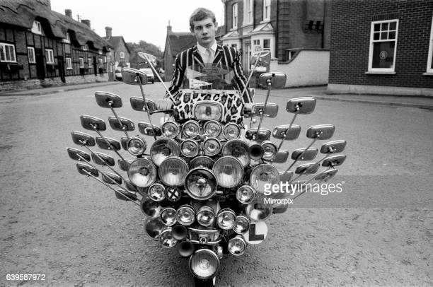 School leaver Bryn Owen aged 17 with his Vespa scooter, which has 34 mirrors and 81 lights on the front and back, all bought with his pocket money....