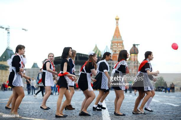 School leavers dressed in Soviet school uniforms perform during celebrations of the Farewell Bell fest marking the end of classes before final exams...