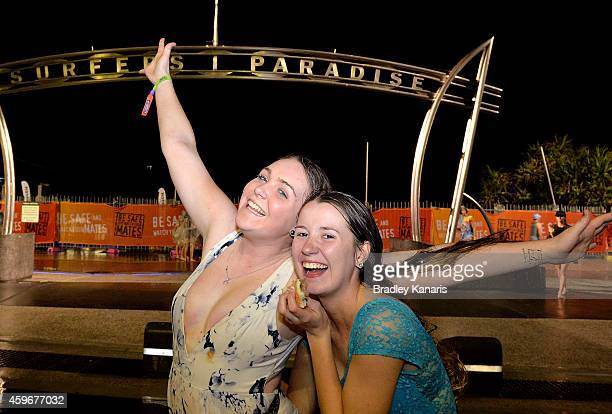 School leavers Maddison Saunders and Brooke Beaumont celebrate during Australian 'schoolies' celebrations following the end of the year 12 exams on...