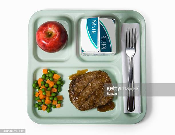 school lunch tray, against white background, overhead view - tray stock pictures, royalty-free photos & images