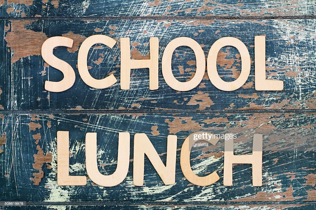 School lunch written with wooden surface on rustic surface : Stock Photo