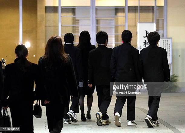 School mates of murdered Ryota Uemura attend a vigil on March 2 2015 in Kawasaki Kanagawa Japan Three teenagers one 18yearold and two 17yearold were...