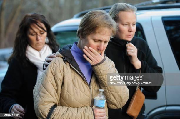 School nurse Sarah Cox speaks outside Sandy Hook Elementary School in Newtown CT A gunman opened fire inside school killing 27 people including 20...