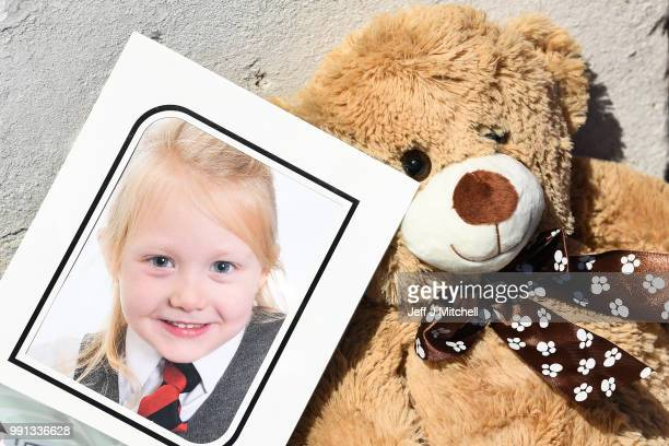 A school picture of Alesha MacPhail is left at a house on Ardbeg road on July 4 2018 in Rothesay Isle of Bute ScotlandThe case has become a murder...