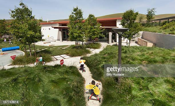 School playground filled green grass and trees