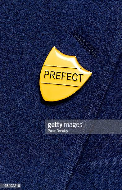 School prefect badge on a blazer