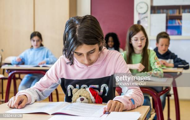 School pupils in Leiderdorp study the Central Final Test, one of the five permitted final tests at a primary school, on April 20, 2021. - More than...