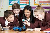 School Pupils In Science Lesson Studying Robotics