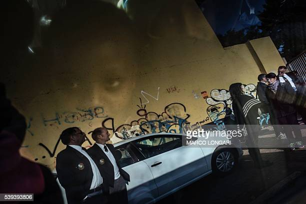 TOPSHOT School pupils look from inside a van at people gathering in Soweto on June 11 2016 at a march held to commemorate the 40th anniversary of the...
