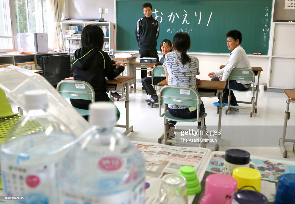 School pupils return to school a week after the magnitude 6.7 earthquake on September 13, 2018 in Abira, Hokkaido, Japan. Concerns are rising about the health of the evacuees because prolonged life in shelters can pose serious risks. Living away from home and together with strangers puts enormous mental and physical strains on evacuees.
