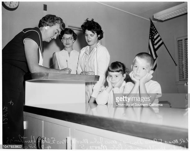 School registration in Van Nuys 2 September 1958 Linda Huntling 5 yearsBob Moore 5 yearsMrs John MooreMrs Elden HuntlingMiss Elsie Davis Caption slip...