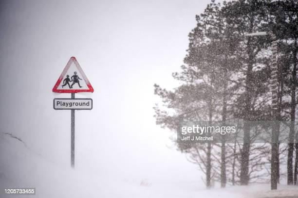 A school road sign is seen through a snow shower on February 11 2020 in Wanlockhead Scotland An amber weather warning of heavy snow showers has been...