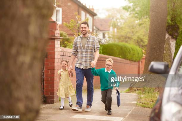 school run dad - carrying stock photos and pictures