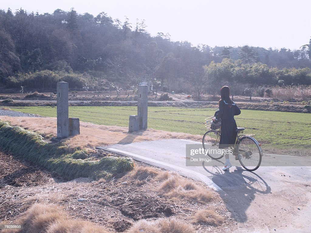 School School girl cycling : Stock Photo